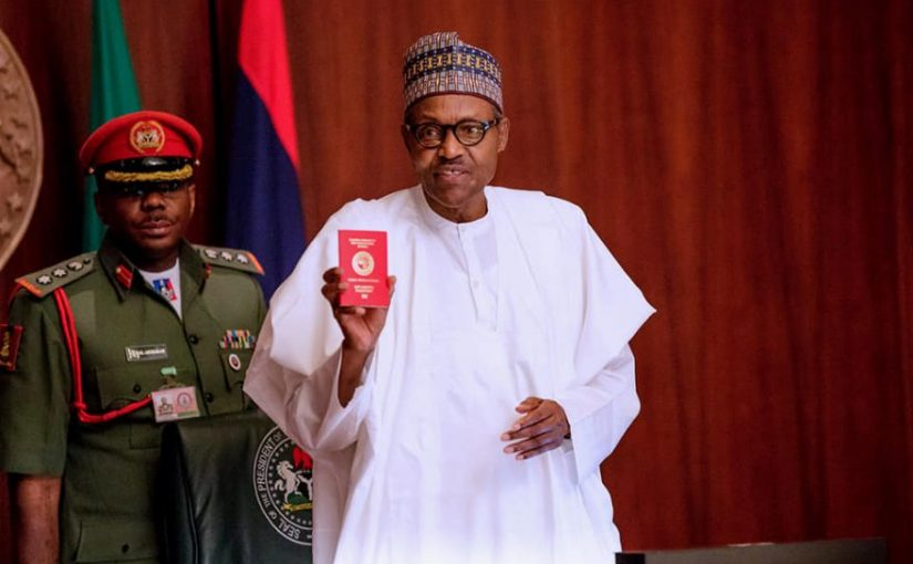 Nigeria Immigration Service (NIS) Present President Buhari Mohammed with a new 10- year Diplomatic E-Passport